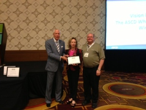 """ASCD Executive Director Dr. Gene Carter presents AL ASCD Executive Director Dr. Jane Cobia and President Dr. Patrick Chappell with the """"Exceptional Progress Award in the Area of Communications"""""""