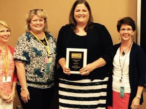 Summer 2015 Outstanding Curriculum Leader Dr. Emily Harris with AASCD Awards Chair Dr. Lisa Beckham