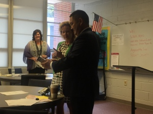 "Ronn Nozoe from ASCD receiving a ""thank you"" gift from AASCD Executive Director Jane Cobia and President Ashley Catrett"